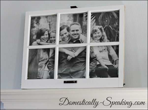 Large family photo display with an old window