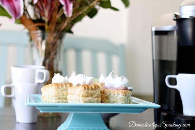 Mini Chocolate Cream Pies on a blue pedestal
