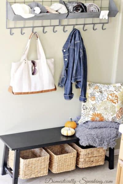 Fall decor in a mini mudroom - perfect to organize your family.