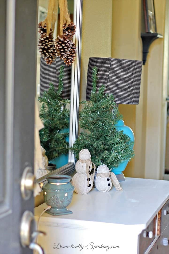 Christmas Home Tour Entry Epsom salt pinecones hanging over mirror