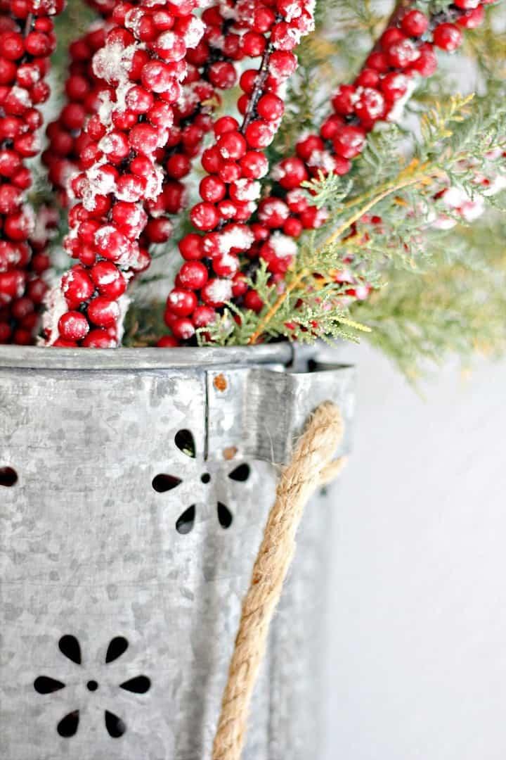 Iced berries in a rustic metal basket