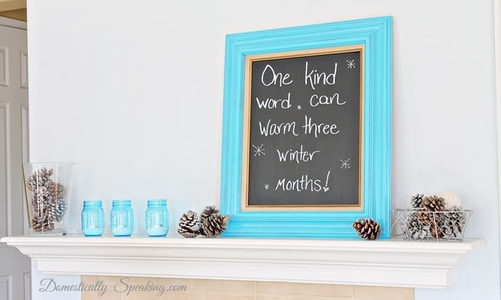 Winter Mantel with Signs of Spring ~ Pincones are a stark winter remember with pops of colorful blue