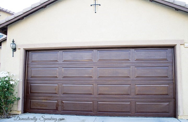 Diy garage door makeover with stain domestically speaking for Faux wood finish garage door