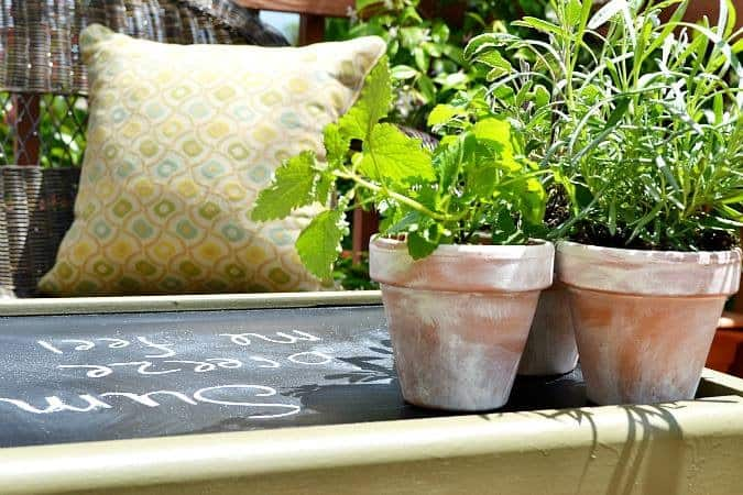 At the Picket Fence: Old TV Stand turned Outdoor Table