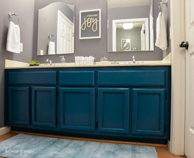 Guest Bathroom Cabinets Painted Blue from Hey Lets Make Stuff