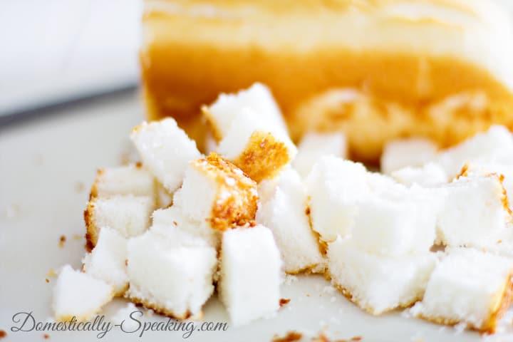 Cut up angel food cake