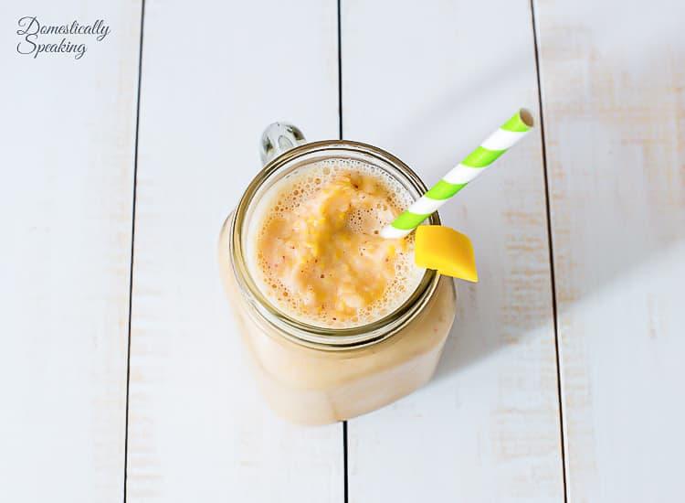 Tropical Mango Smoothie in a mason jar.
