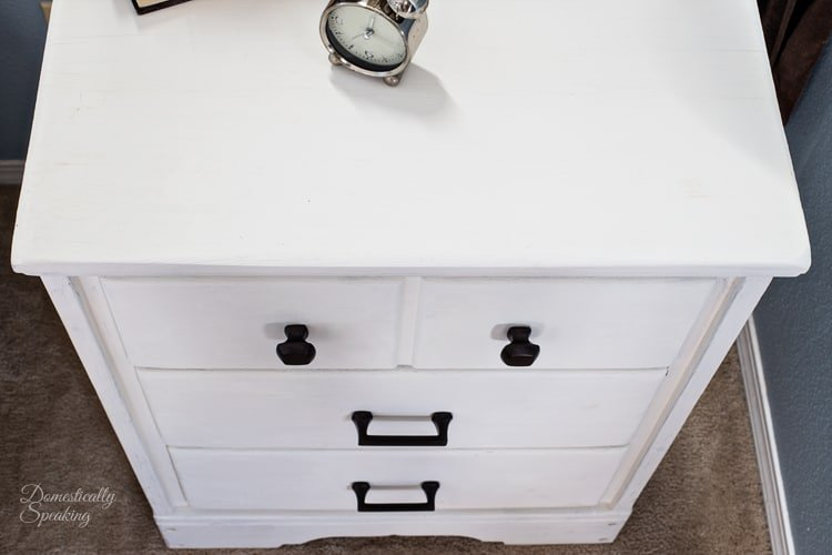 Top of creamy white nightstand painted with chalk paint it use to be an old desk