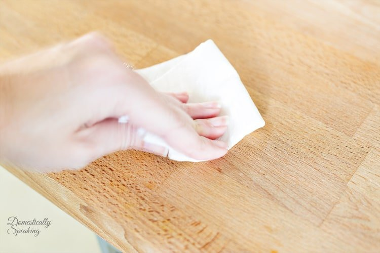 Wiping butcher block stain with white vinegar