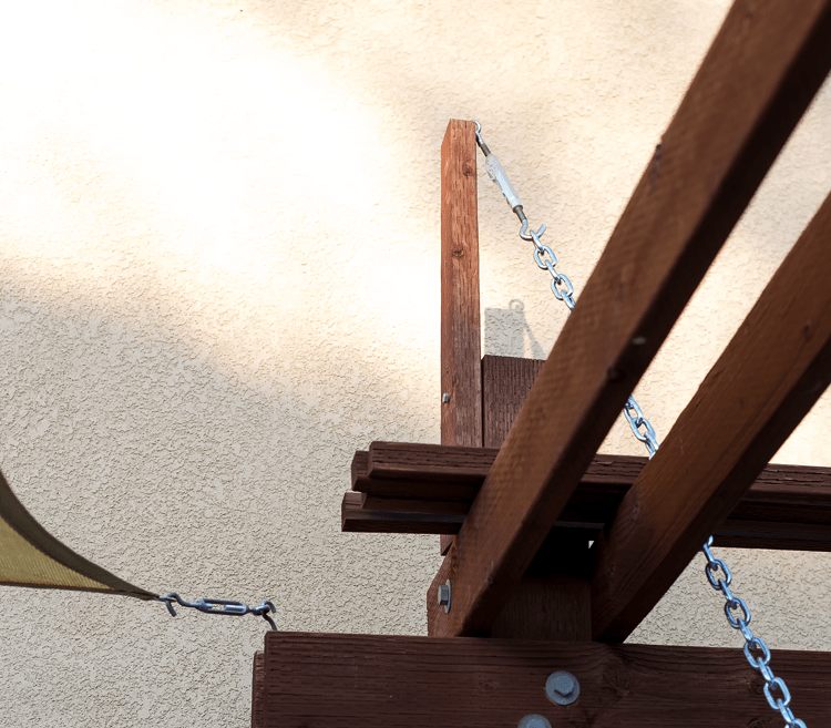 Adding hooks and chain to make an outdoor hanging bed