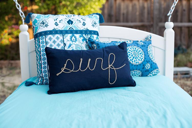 Beautiful Coastal Pillow on a DIY Hanging Outdoor Bed