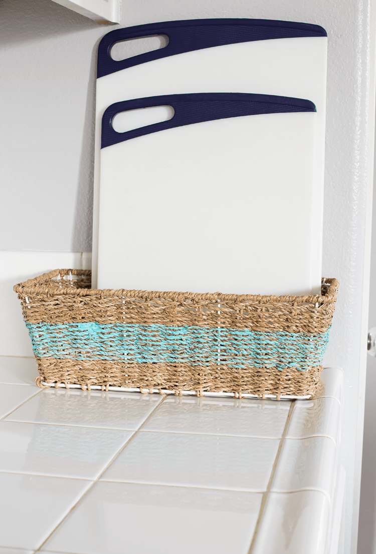 Easy Thrift Store Makeover Striped Basket to hold Cutting Boards