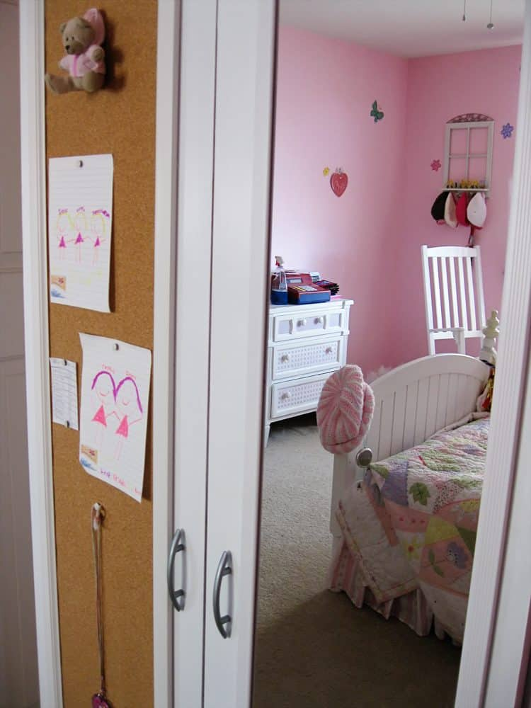 Ikea wardrobe updated with paint, molding, mirror and corkboard