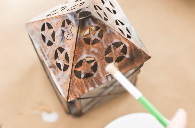 Adding white glue to the copper lantern | Chippy Lantern with Glue