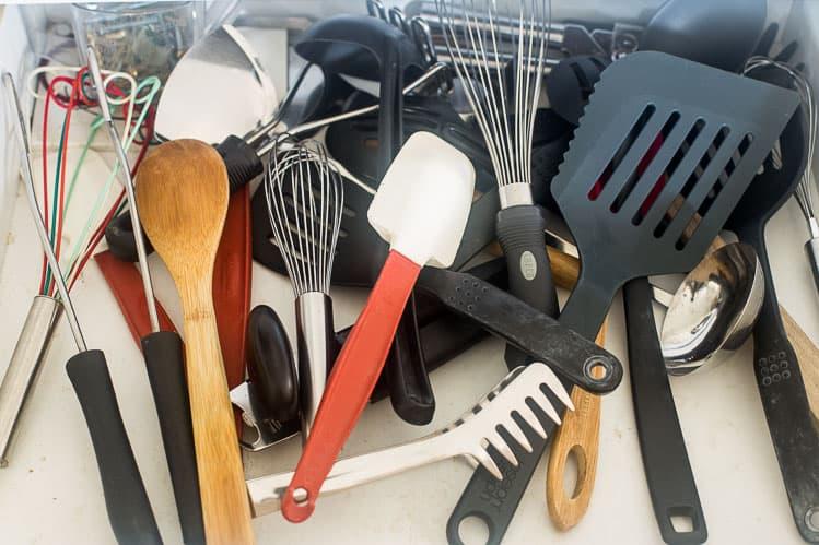 Messy kitchen drawer before DIY Drawer Organization