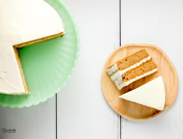 2 slices of carrot cake and a green cake stand.