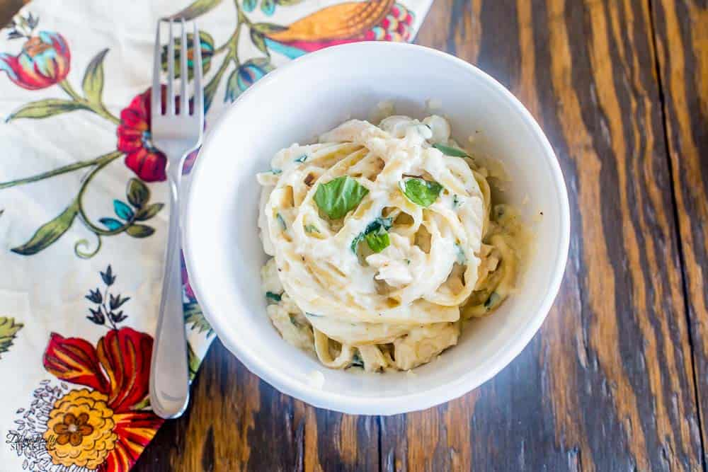 Fettuccine with Chicken in a creamy garlic, basil and parmesan cheese sauce.