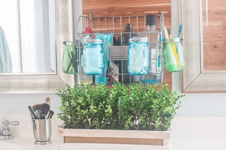 Hanging blue and green mason jars with plumbing clamps