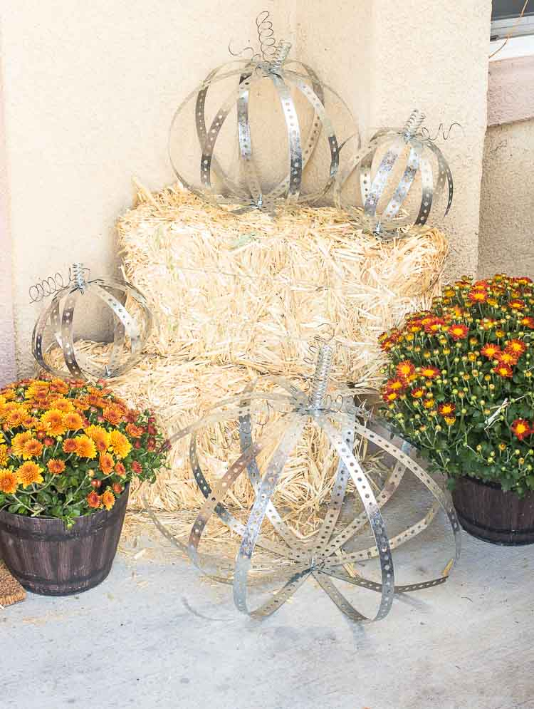 Rustic Industrial Autumn Porch with a Large Wood and Metal Lantern, Leaf Wreath, DIY Metal Pumpkins, Gather Doormat and lots of Fall Mums