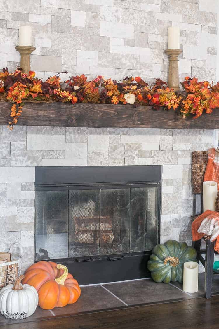 Faux stone and wood mantel with fall decor