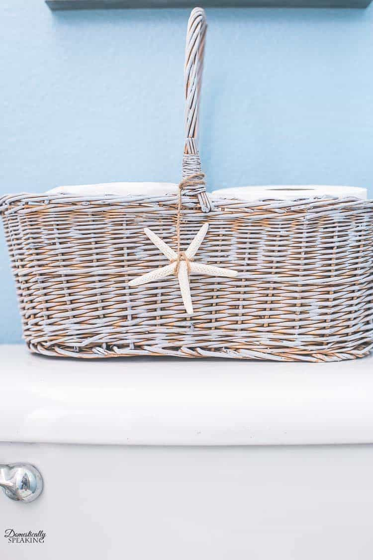 $1 Thrift Store Basket gets a Paint Makeover and turns into a Painted Toiled Paper Basket with a cute starfish and twine.  #thrift #basket #paint