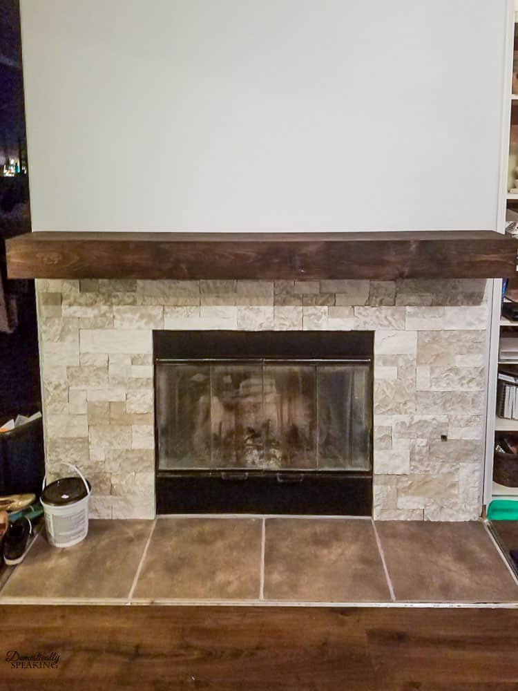 Learn how to build your own RUSTIC FIREPLACE MANTEL with step-by-step directions. Super easy to make and then customize how you want it.