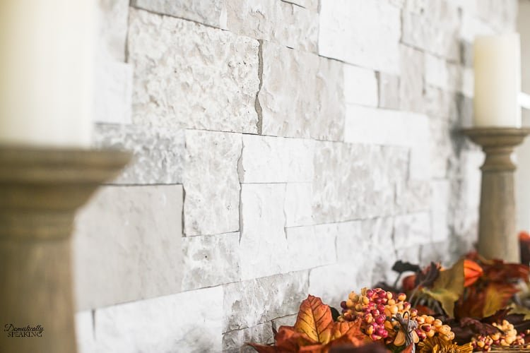 Faux stone above a fall mantel.
