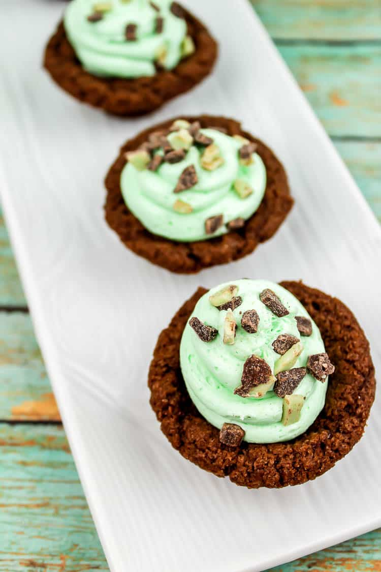 Andes Mint Chocolate Cookie Cups are an easy baked treat that is packed with that chocolate and mint that you love! These bite sized desserts are perfect for St. Patrick's Day, showers, birthdays or anytime.