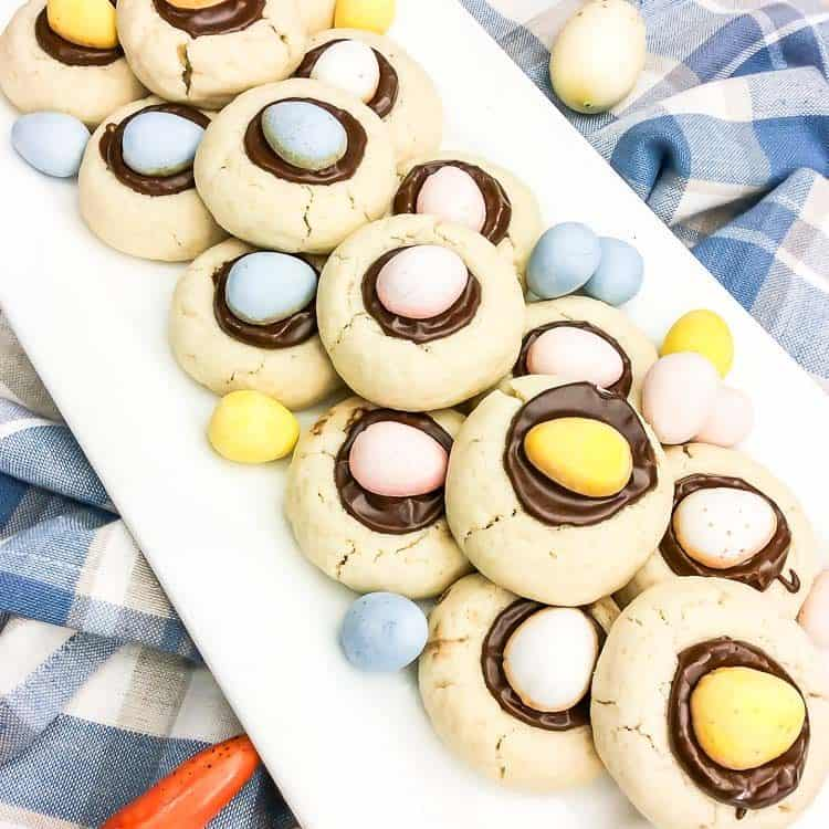 Cadbury Egg Easter Cookies | a white platter filled with Spring Cookies