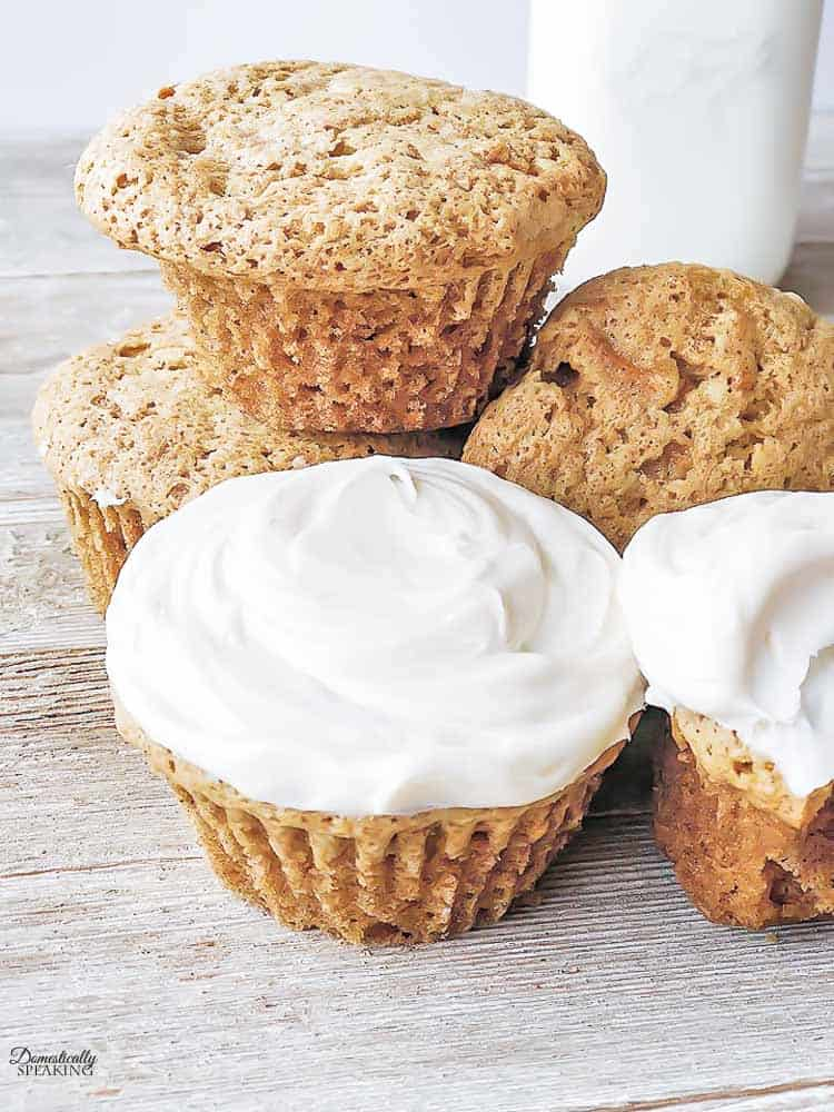 Simple Carrot Cake Cupcakes on a wood board