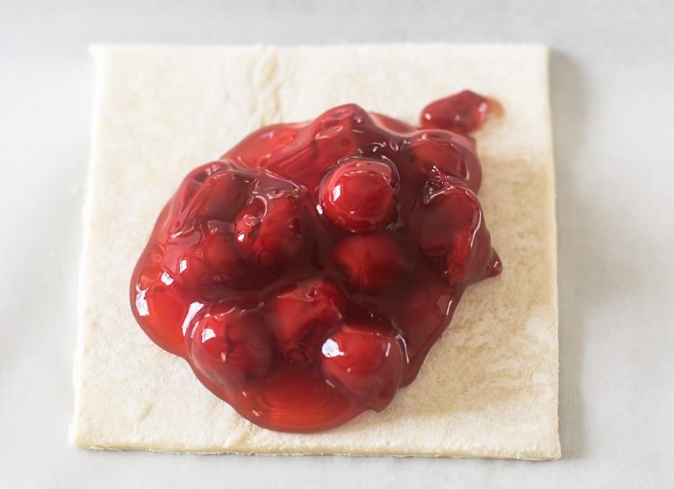 These are the easiest Cherry Turnovers!!!  Cherry filling on a puff pastry.