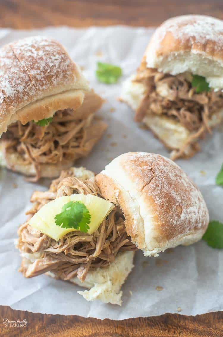 Crockpot Hawaiian Pulled Pork Sliders are moist and juicy sandwiches that are a great weeknight dinner idea. Delicious pineapple, garlic, soy sauce and more!