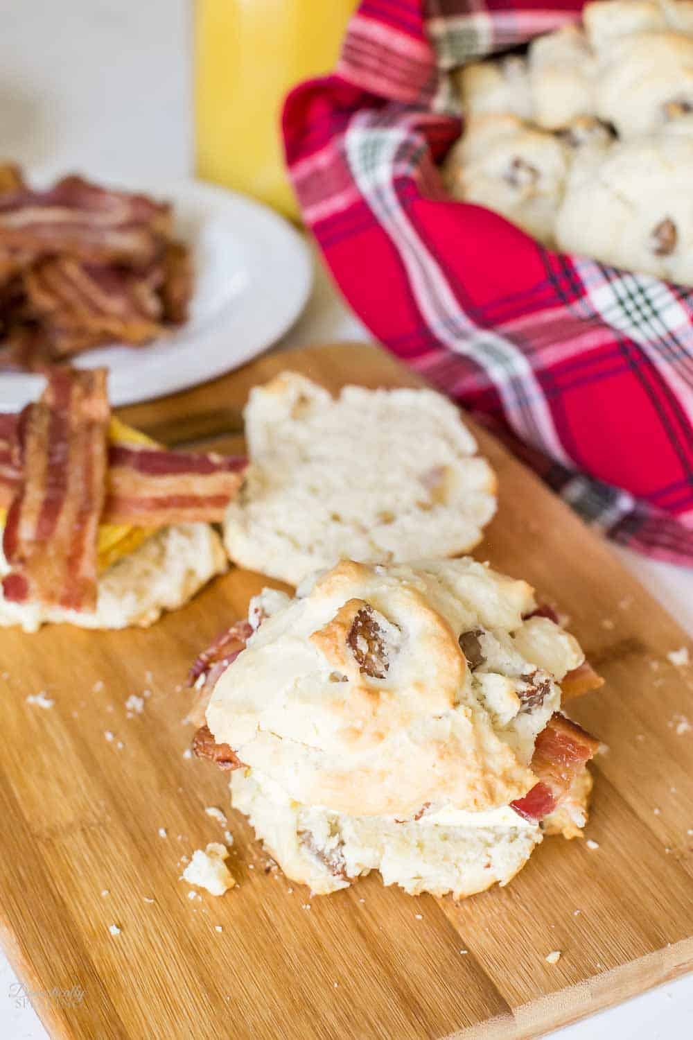 Sausage Biscuit Breakfast Sandwiches on a cutting board.