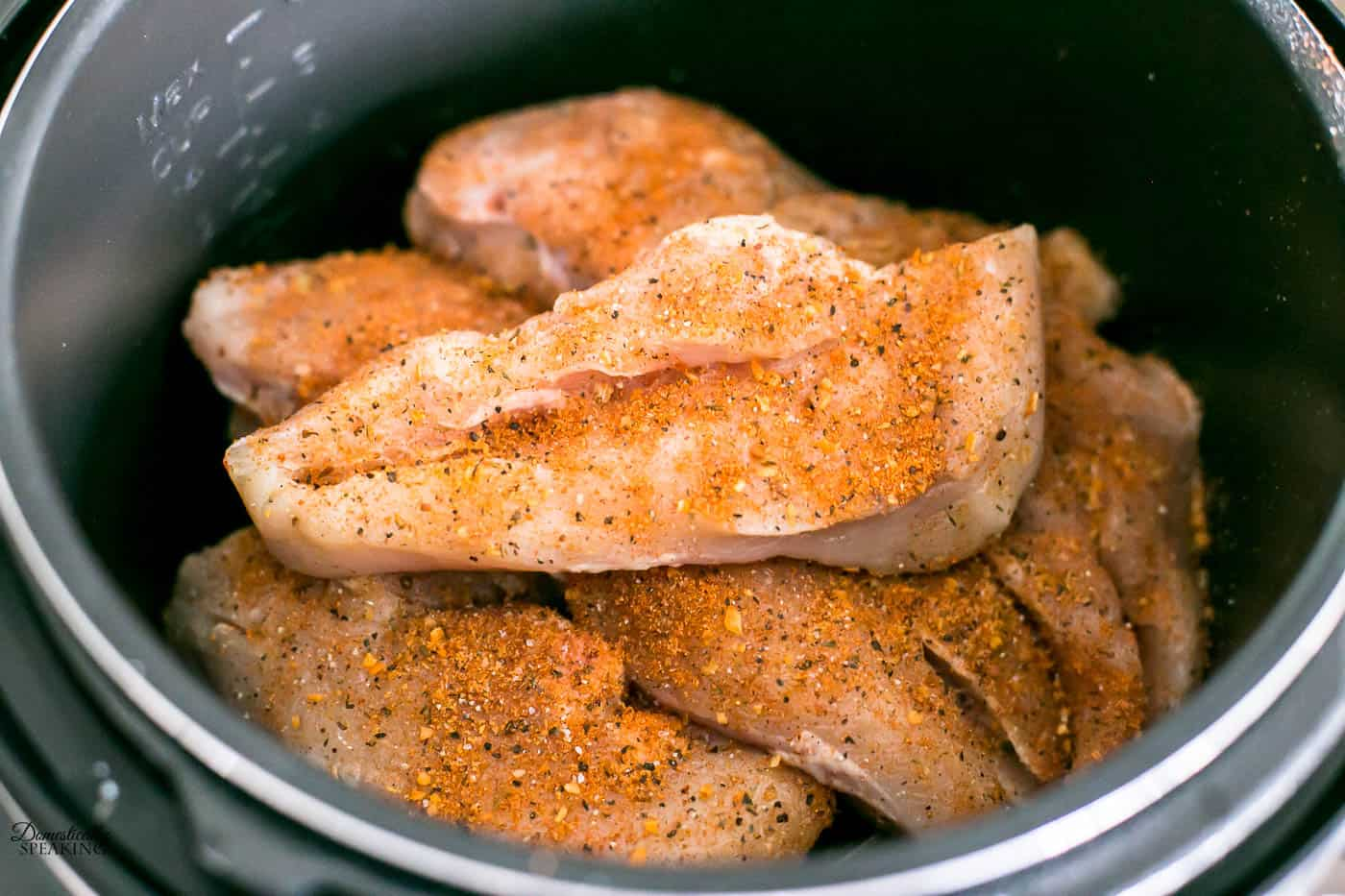 Seasoned chicken breast in pressure cooker.