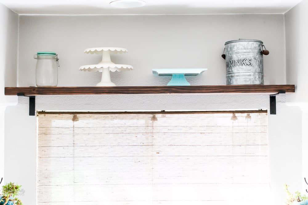 Wood shelf with farmhouse decor on top