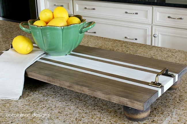 wood tray with stripe and a bowl of lemons