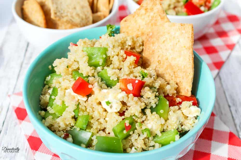 Quinoa Salad with Peppers in a blue bowl.
