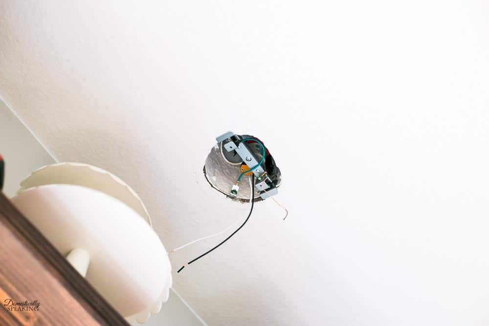 Connecting the wires to install the recessed lighting converter kit.