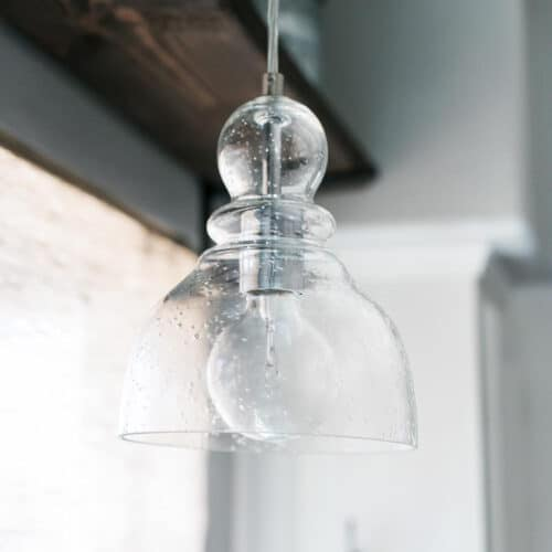 Beautiful Seeded Glass Pendant Light hanging in the kitchen.