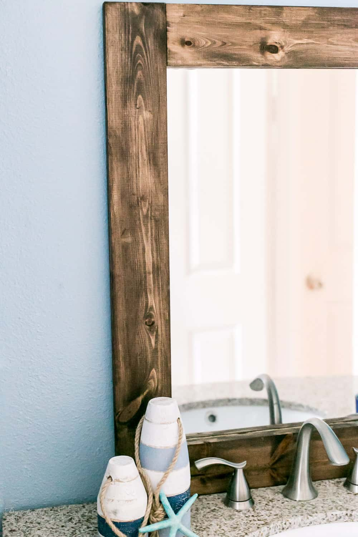 Rustic Wood Frame for a bathroom mirror - a great DIY.