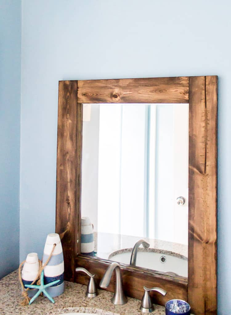 How to turn a thrift store mirror into a DIY Rustic Wood Mirror with this tutorial.