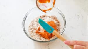 Adding the pumpkin puree to the batter.