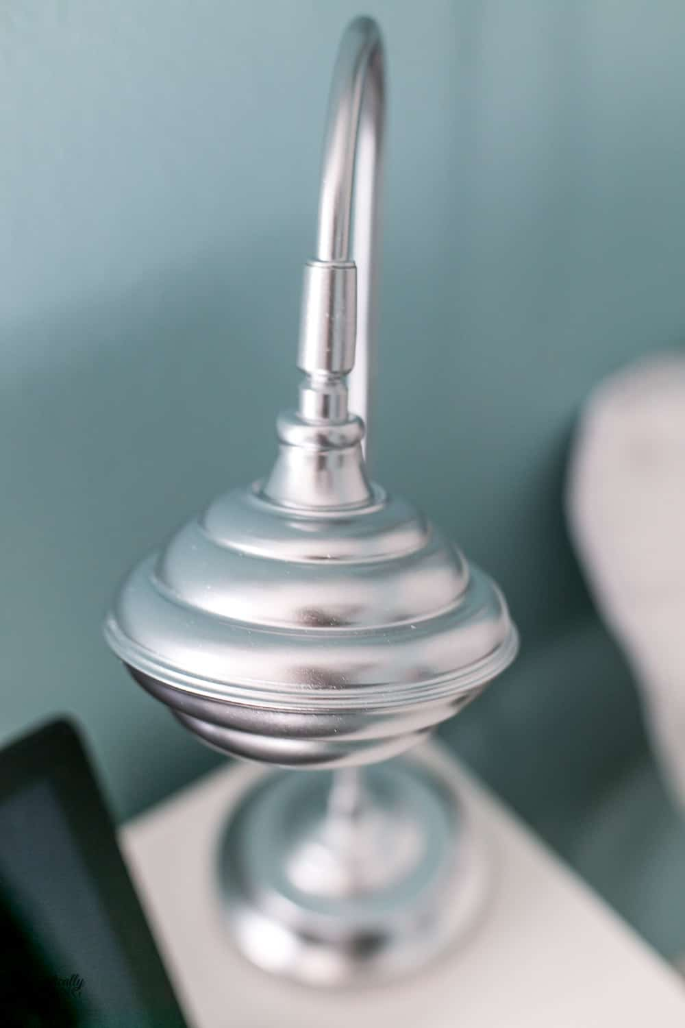 Closeup of a spray painted chrome desk lamp