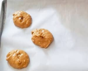 Placing the cake mix whoopie pie batter onto parchment paper.