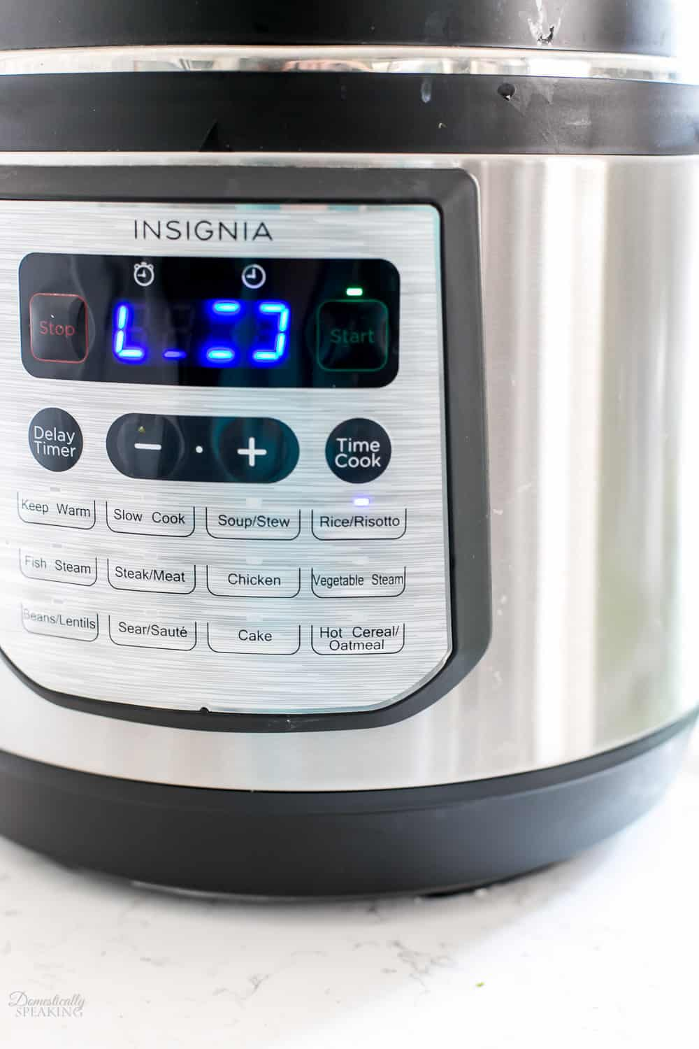 Setting your instant pot to rice setting.