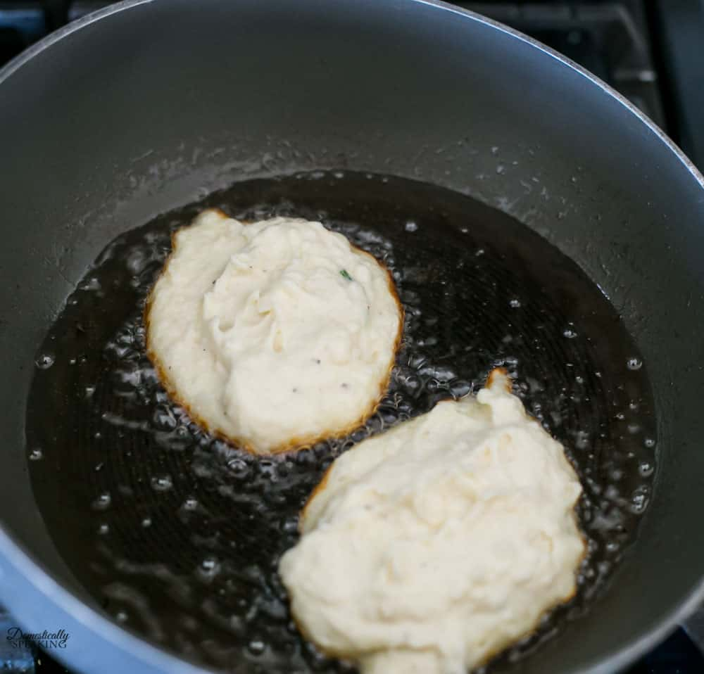 Frying up the potato cakes.