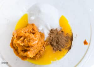 Egg yolks, sugar, pumpkin puree, and cinnamon for pumpkin custard.
