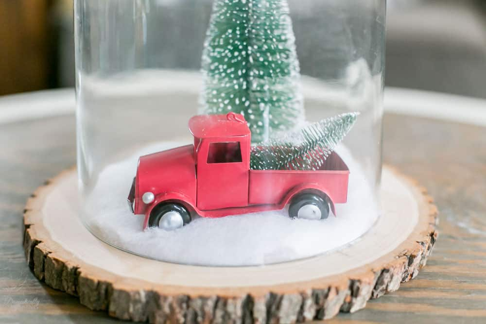 Wood Slice, Snow, Red Vintage Truck and a Bottle Brush Tree.