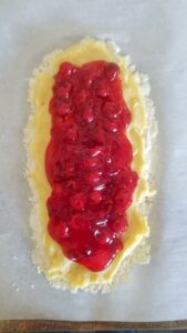 Spoon cherry pie filling on top of the almond pastry cream.