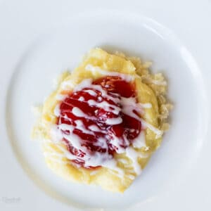 Almond Cherry Pastry with a drizzle of almond icing.